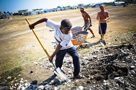 Haitian boy with shovel